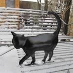 Black cat fence capper