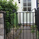 Victorian town house gate oak leaf design