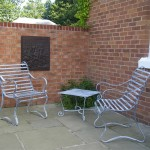 Garden seats and table set for sunny patio