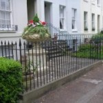 classical-railings-and-gate-for-Regency-town-house-Hand-forged-finials-for-elegance